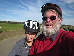 Lily and Granddad on mountain bikes